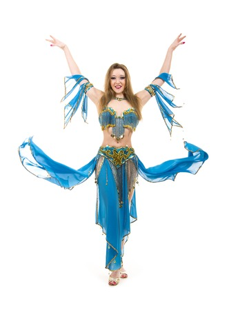 Attractive girl dancing belly dancer on isolated white background. Standard-Bild - 100869021