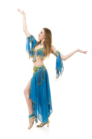 Attractive girl dancing belly dancer on isolated white background.