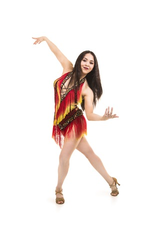 A young girl, with long dark hair, dances and performs in an airy ring in a stage costume. Studio shooting, isolated image.