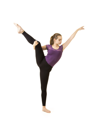 Young girl with long hair dancing modern ballet. Studio shot on white background. Isolated image. Imagens