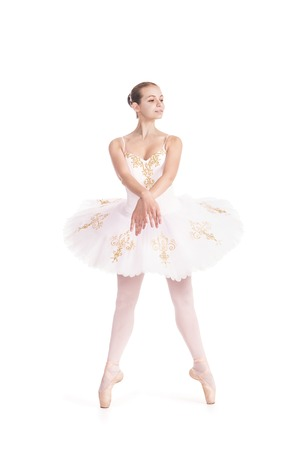 Girl in white tutu dancing ballet. Studio shot on white background , isolated image.
