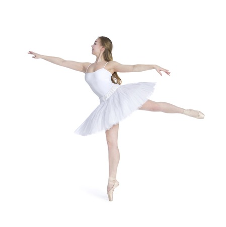 A girl with long hair, in a white tutu dancing ballet. Studio shot on white background , isolated image. 免版税图像