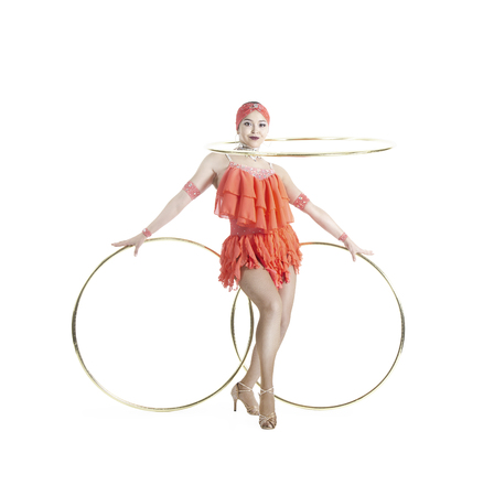 A girl in a stage dress performs a dance with a Hoop. Studio shooting on a white background. Stock Photo