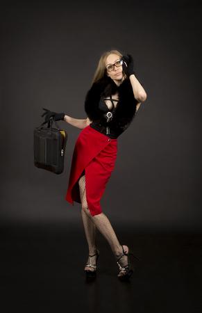 Sexy teacher in black lingerie.Studio shooting on a dark background.