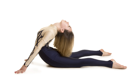 Girl gymnast, in a blue and white suit, engaged in acrobatics. Isolated images on white background.