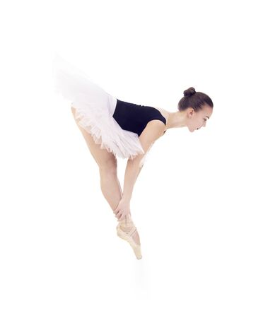 Gorgeous ballerina, in a white tutu dancing ballet. Studio shot on white background , isolated images. Foto de archivo