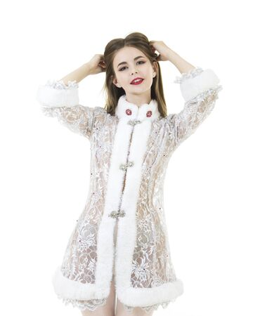 Beautiful young woman with long hair, dressed in white christmas costume. Isolated images on white background.