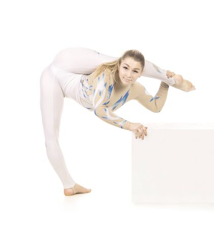 Acrobat doing gymnastics, a young circus artist in a white and blue suit, performs acrobatic elements. Studio shooting isolated image on white background.