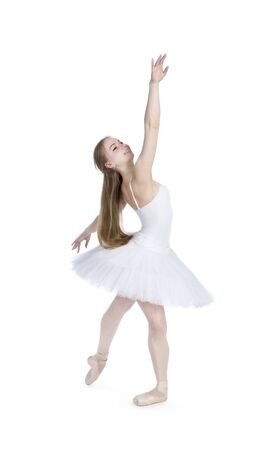 A girl with long hair, in a white tutu dancing ballet. Studio shot on white background , isolated image. Banque d'images