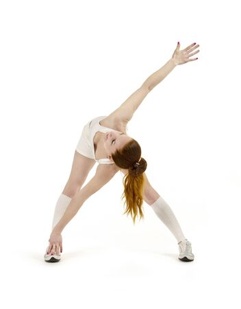 Young woman is engaged in fitness and yoga. Studio shot on white background. The isolated image.