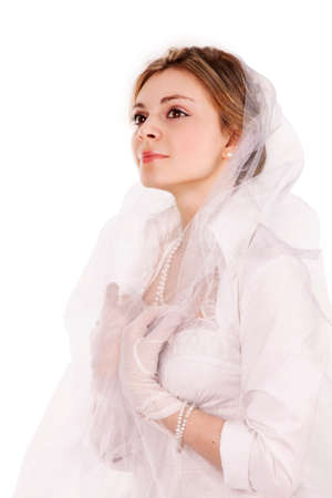 Portrait of a charming girl in a white dress in retro style, the bride in a retro dress. Studio shooting on a white background.