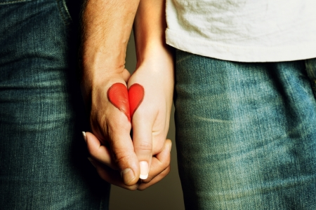 red heart drawing on the hands of couple Stock Photo - 16777662
