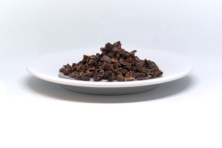 cacao nibs on a plate isolated