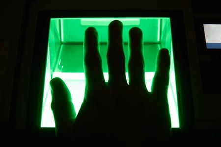 green cybersecurity digital fingerprint scanning on a green screen Reklamní fotografie