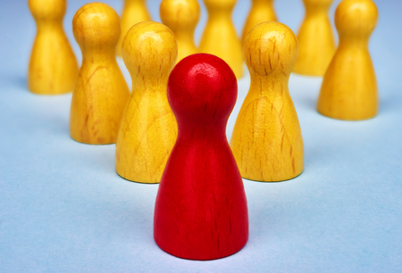 chief executive officer: Symbol for leadership with game figures - macro shot Stock Photo