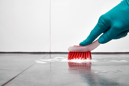 Cleaning concept - Cleaning the floor in the shower.