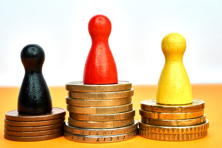rostrum: Money winner concept with game figures - close-up. Stock Photo