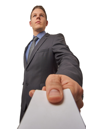 professionally: Isolated business man submits a calling card. With copyspace on the card.