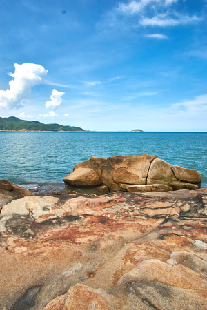 hon: Vertical shot of the sea with a dramatic sky and rocks in the foreground - Hon Chong - in Nha Trang, Vietnam.