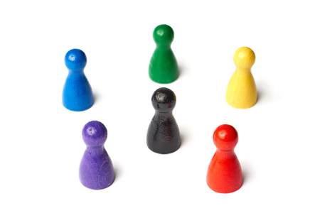 Six game figures standing in a circle with a black figure in the middle. Symbol for a color wheel or a group of people or teamwork