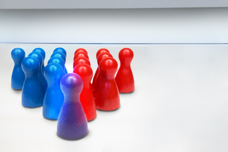 Merging or combining game figures. Leadership or teamwork business concept. With copyspace.