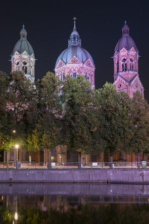 St. Luke Church near Isar river and Wehrsteg bridge, Munich, Germany.