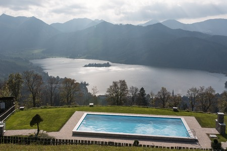Schliersee from the view of the Schlierseealm with a swimming pool in the foreground.