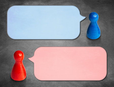 Game figures with angled speech bubbles with blackboard backgrou