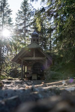 Small chapel in the forest in germany bavarian forest - Osserkapelle on the Osser. With heavy lensflare. Standard-Bild