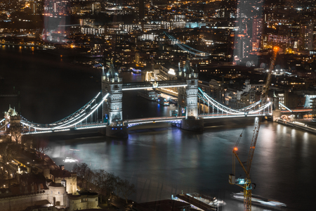 London, England - Tower Bridge and River Thames aerial view with reflections. Standard-Bild
