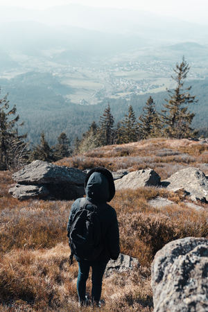 Unrecognizable woman is hiking in the upper bavarian forest in the near of the Osser, germany. Color graded.