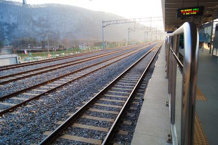 Railroad straight track photo