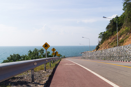 Roadway with beautiful seaside scene along this road. Capture at Rayong, Thailand photo