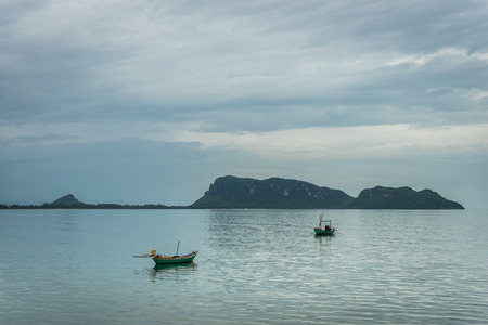 ao: Beautiful scenic of the Ao Thai sea with the boat and islands in the background. Stock Photo