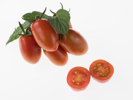 Appetizing red mini-tomato on white background