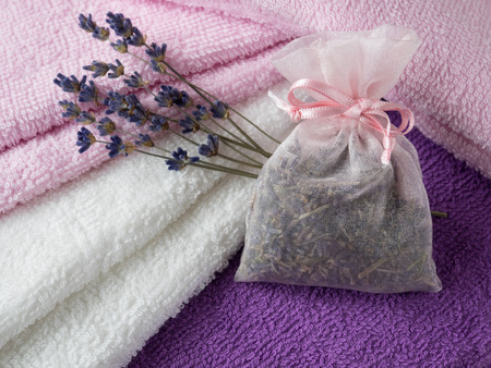 Sachet of the lavender herb and cotton towels photo
