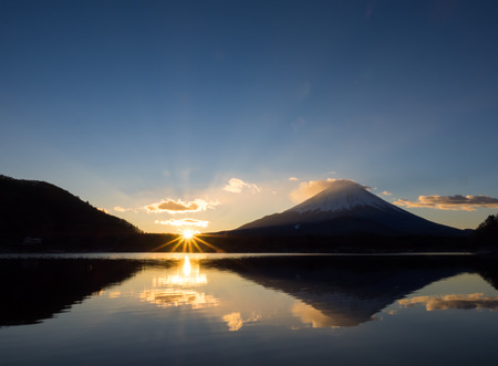 ridgeline: The morning sun rises from ridgeline of Mount Fuji at shore of Lake Shojinko