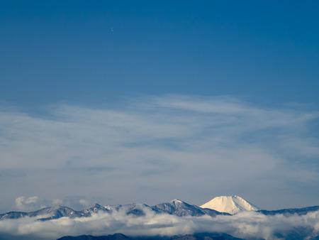 Winter Tanzawa mountain range and Mount Fuji looked at from Kanagawa Stock Photo