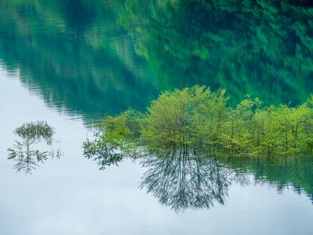 Beautiful emerald green lake_Okushima Lake in japan Stock Photo