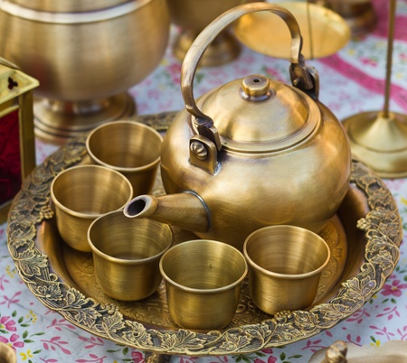 Gold teapot on the tray