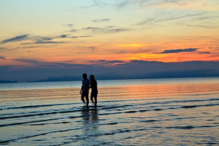 A woman walk a man during as they watch the sunset Stock Photo - 13336001