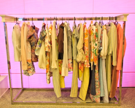 clothes of different colors on hangers