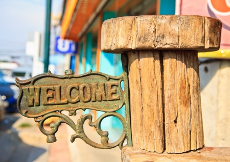 Old the sign for welcome and wood photo