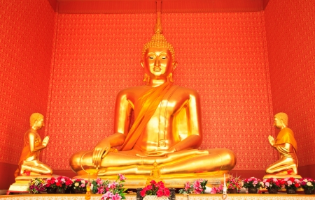 Buddha statue and Thai painting background photo