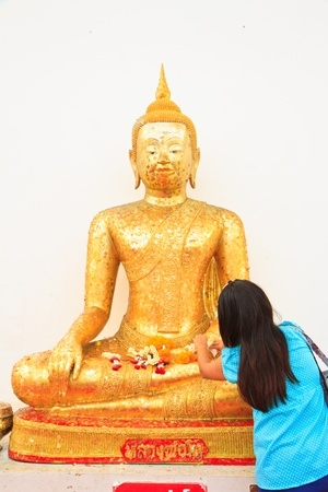 Buddha image in Thailand and women photo