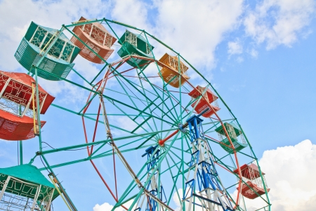 Ride on Ferris wheel in Amusement Park