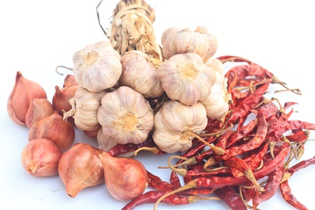 Onion,Chilli and Garlic isolated on white background photo