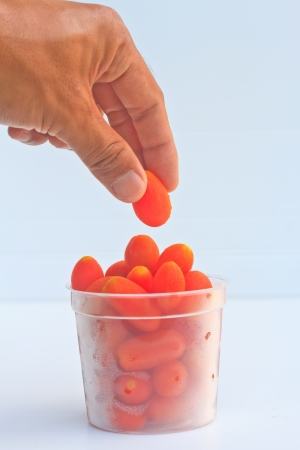 tomatos in cup and glove  photo