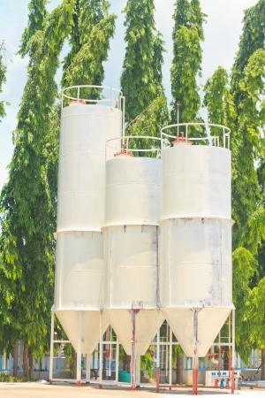 Three silos against sky photo