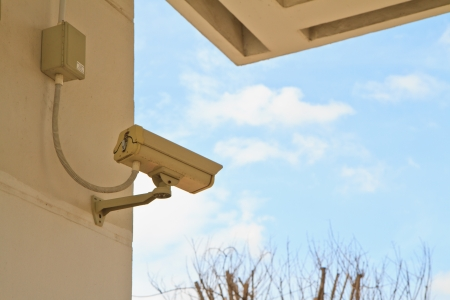CCTV security camera at home and blue sky photo